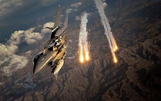 Military Stock Photos F-15E Stock Photos F-15E Strike Eagle - Combat - Flares - Afghanistan - Royalty Free
