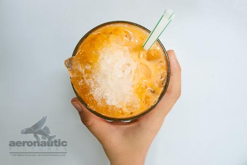 Food Stock Photos - A Hand Holding a Glass of Thai Iced Tea