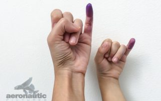 Parenting Stock Images: Electoral Ink Marks Mother & Child's Pinky Fingers