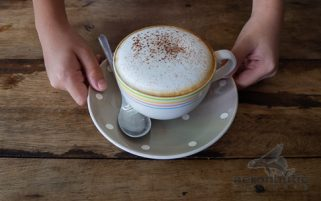 Coffee Stock Photo - Child's Hands Holding Cup of Cappuccino
