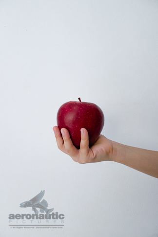 Food Stock Photo - A Child's Hand Holding an Apple Royalty Free Download