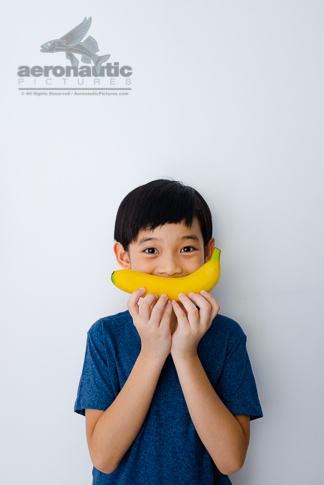 Food Stock Photo - A Kid and a Banana Smile Download Royalty Free
