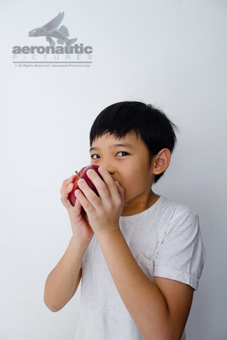 Food Stock Photo - A Kid Eating an Apple Royalty Free Download