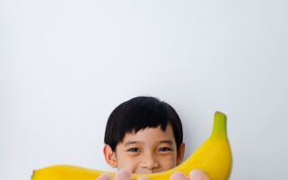Food Stock Photo - A Kid Holding a Banana Download Royalty Free