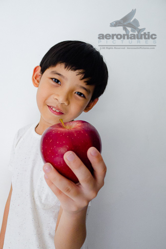 Apple Stock Photo - A Kid Holding a Red Delicious Apple