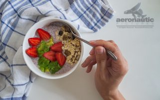 Food Stock Photo - A Hand Scooping Chia Pudding Download Royalty Free